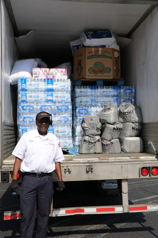 Mountaire Farms driver Ronnie Rouse with a load of relief supplies for employees at the company's Lumber Bridge, N.C., processing plant.