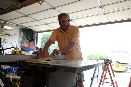 Local artisan Gary crowl makes collages out of driftwood he finds along the Delaware coast.