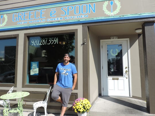 Greece e Spoon owner Greg Lee stands in front of his restaurant. The popular Greek restaurant was featured on Greek television for their twists on popular Greek foods.