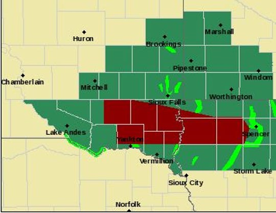 Flash flood warnings (in red) have been issued for parts of southeast South Dakota, while flash flood watches (in green) have been declared for other parts of the region.