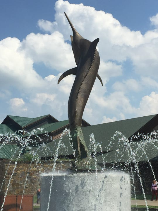 A two-story-tall bronze casting of a 1,000-pound black marlin caught in Australia greets visitors to WOW National Museum and Aquarium. Yes, even marlin have been caught on fly rods.