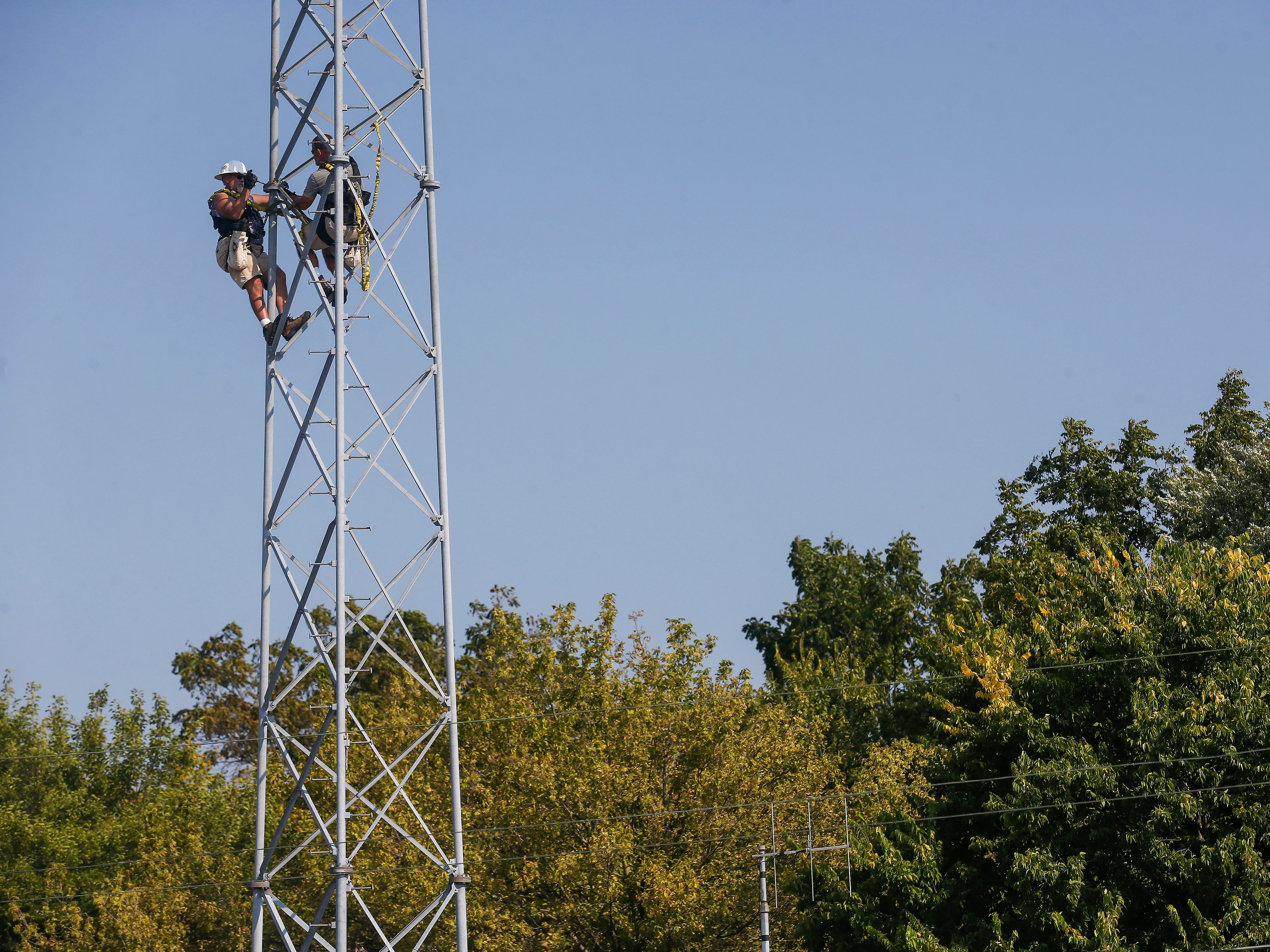 Craig House, right, and Tim Sloan, both of DIY Broadband, disassemble an old pager tower on Thursday, Sep. 20, 2018. The tower was located on property just purchased by Arnie's Plumbing, Heating and Air Services near the intersection of Chase Street and Lyon Avenue.