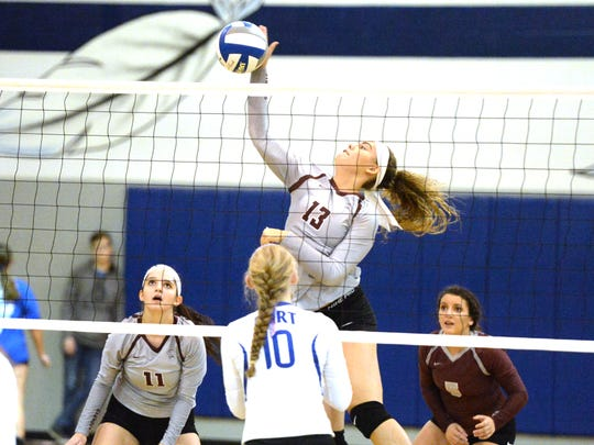 Stuarts Draft's Madie Varner (13) attempts a kill Wednesday against Fort Defiance.