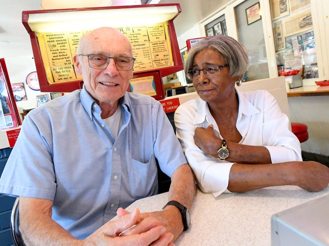 "Forester Wright, Jr. and Barbara Lee share a moment, sitting together for an interview on Sept. 19, 2018. He is the one who hired her as the first African-American ""curb girl"" to work at Wright's Dairy-Rite in Staunton 53 years ago."