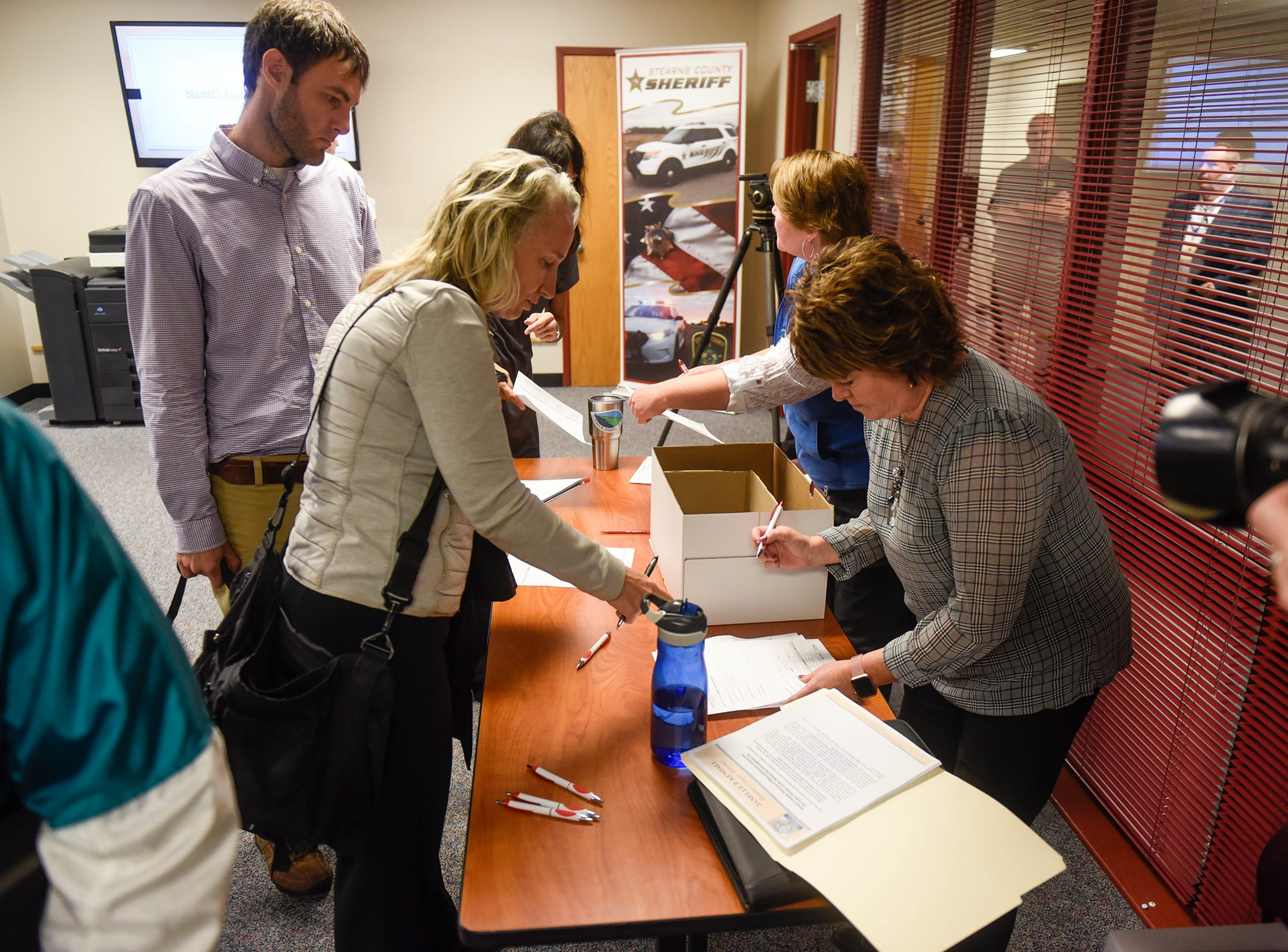 Drives containing files in the Jacob Wetterling case are handed out following a press conference for the release of the information Thursday, Sept. 20, 2018, in St. Cloud.