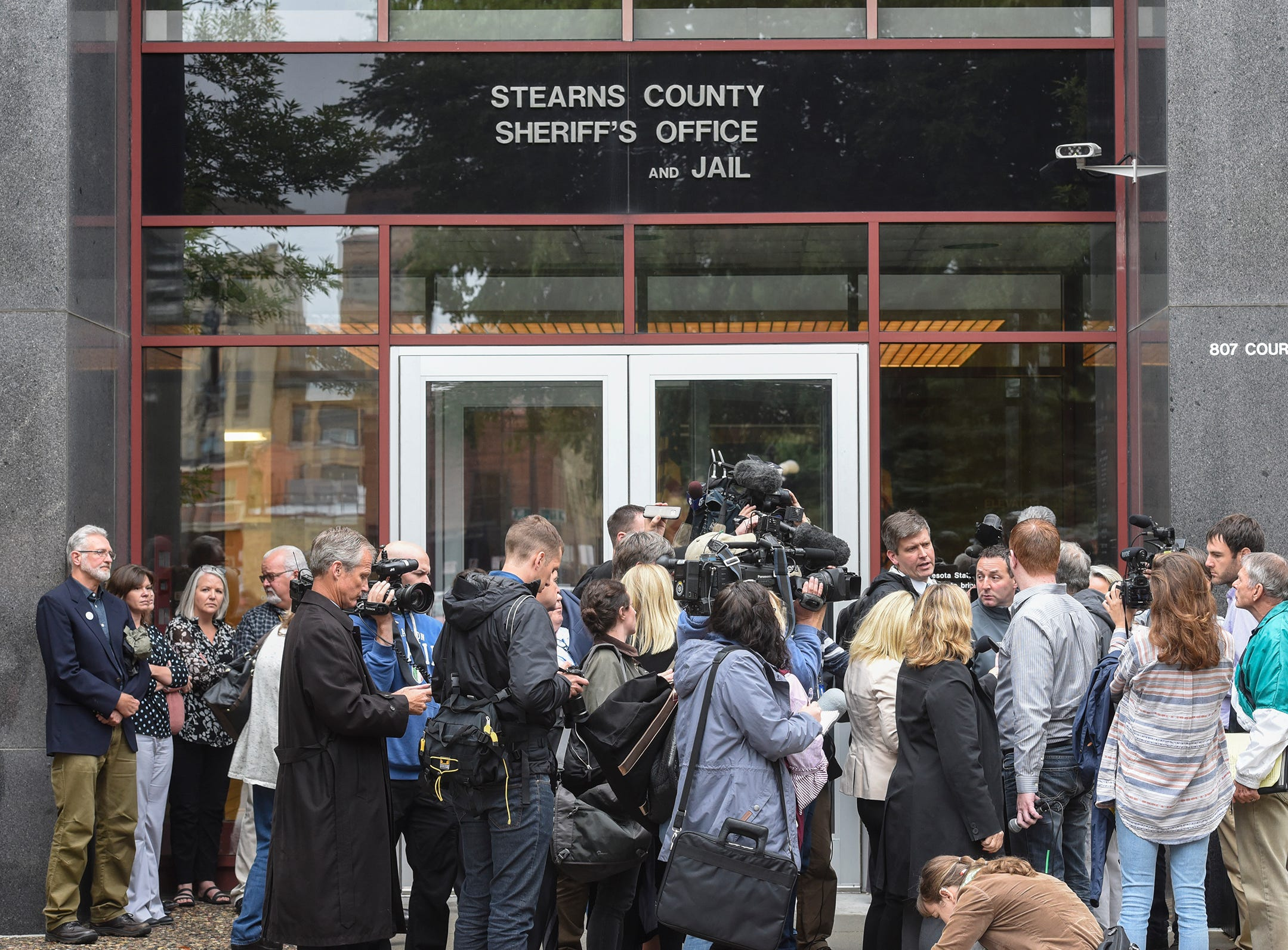 Reporters gather outside the Stearns County Sheriff's Office following a press conference for the release of investigative files in the Jacob Wetterling case Thursday, Sept. 20, 2018, in St. Cloud.