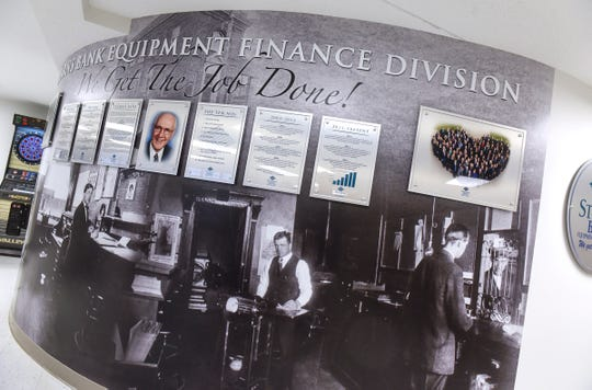 A mural outlines the history behind the Stearns Bank Equipment Finance Division Wednesday, Sept. 19, in Albany.