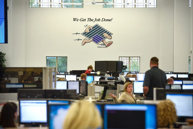 Employees work their assignments Wednesday, Sept. 19, at the Stearns Bank Equipment Finance Division in Albany.