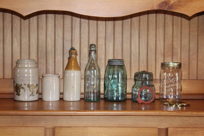 Antique canning vessels from Al Cooper's collection reflect 100 years of home-preserving history.