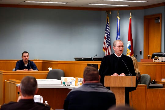 Portage County Circuit Judge Thomas Flugaur speaks about Brandon Jagodzinski during his graduation ceremony from the Portage County drug court in Stevens Point, Wis., Monday, Sept. 17, 2018.