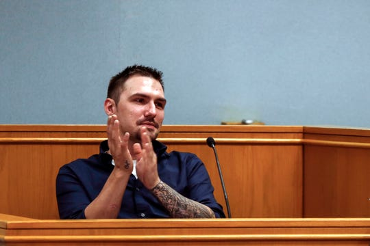 Brandon Jagodzinski claps for people involved in the drug court program during his graduation ceremony from the Portage County drug court in Stevens Point, Wis., Monday, Sept. 17, 2018.
