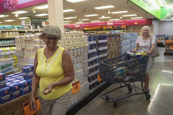 Neighbors Regan Liburd, left and Patricia Sanford shop together at the newly opened Fresh 4 Less grocery store located in the former Winn-Dixie store on North Monroe Street in Tallahassee, Fla. Thursday, Sept. 20, 2018.