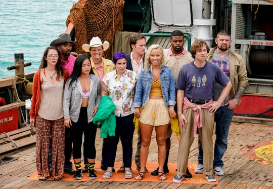 """The David Tribe, including FAMU professor Christian Hubicki, right front, competes on """"Survivor."""""""