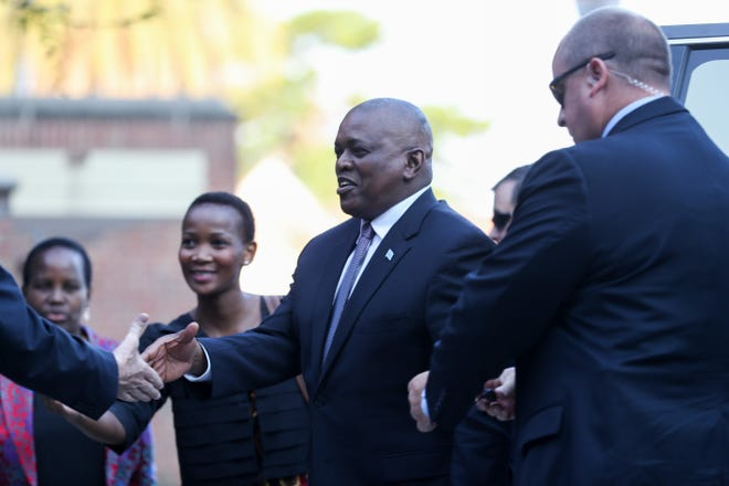 President of the Republic of Botswana Mokgweetsi Eric Keabetswe Masisi arrives and shakes hands with Florida State University President John Thrasher at the Westcott Building on the Florida State University Campus in Tallahassee, Fla. Thursday, Sept. 20, 2018.