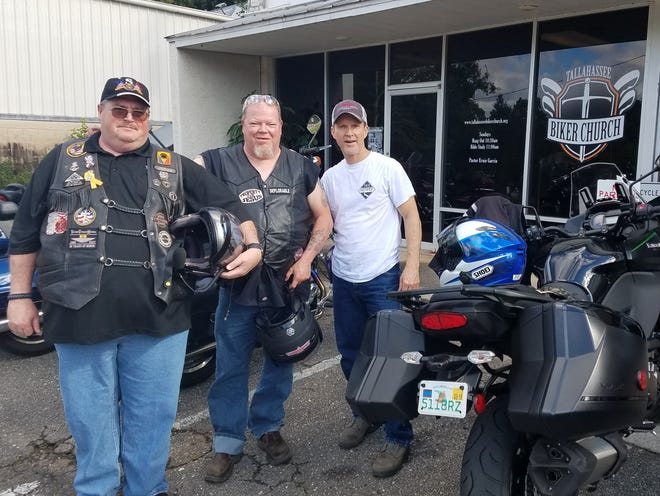 James Mearse, Greg Scrivener, Catfish Thompkins...all members of the Biker Church standing by their rides Sunday morning as they head in to worship.