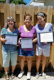 Volunteers Jan, Donna, and Carolyn, being recognized for their dedication and efforts at the Humane Society Thrift Store.