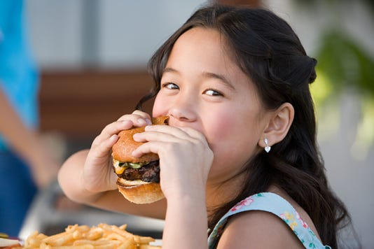 Girl Eating A Burger