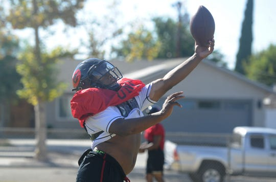 Lontrelle Diggs shows he can also catch the ball during Grace Brethren's practice on Wednesday. Diggs has rushed for for 711 yards and 10 touchdowns for the 3-2 Lancers, who play at Westlake on Friday night.