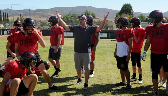 Head coach Josh Henderson has a point to make at Grace Brethren's practice Wednesday. The Lancers play at Westlake on Friday night.