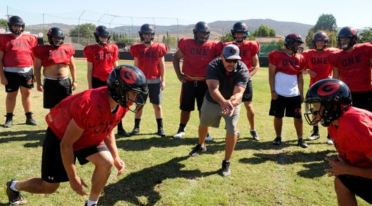 Head coach Josh Henderson (center) isn't sure how much higher the Grace Brethren football program can ascend. One thing's for sure, the Lancers have come a long way from their 8-man football days.
