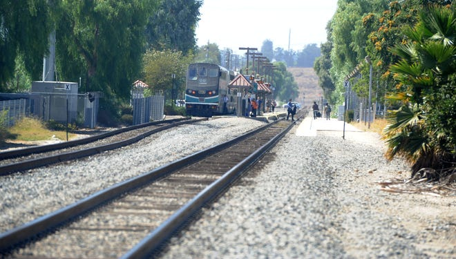 STAR FILE PHOTO Amtrak customers get off a train at a Moorpark station in this file photo.