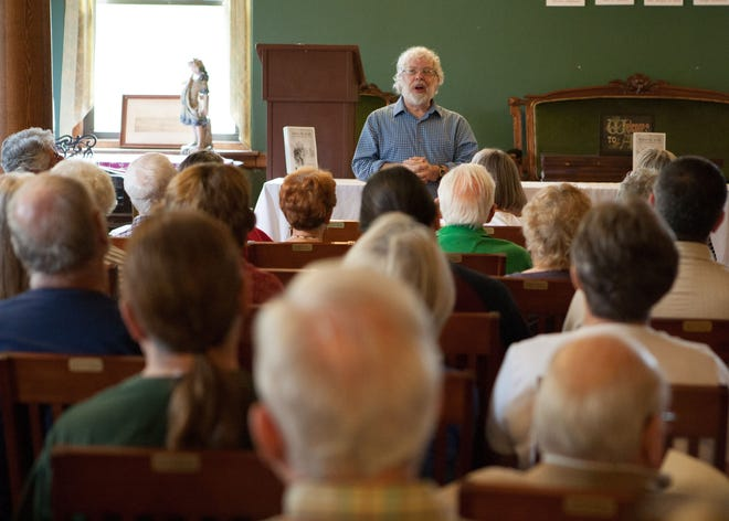 """Author Vince Farinaccio discusses his new book, """"Before the Wind: Charles K. Landis and Early Vineland,"""" during a recent book signing at the Vineland Historical and Antiquarian Society."""