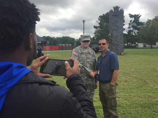 Vineland High School Class of 2018 graduate Alaattin Ardahan returned to his alma mater as a New Jersey Army National Guardsman on Thursday. He greets his former teacher, Bob Rush, of Jobs for America's Graduates program.