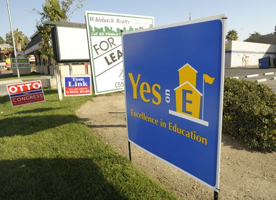In this file photo, a sign for Measure E sits in the 2500 block of South Mooney Boulevard in Visalia.