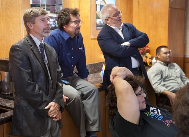 In this file photo, former Visalia Unified Superintendent Craig Wheaton, left, and Measure E committee co-chair Amy Shuklian watch elections results with Measure E supporters at Mangini Associates in Visalia on Tuesday, November, 6, 2012.