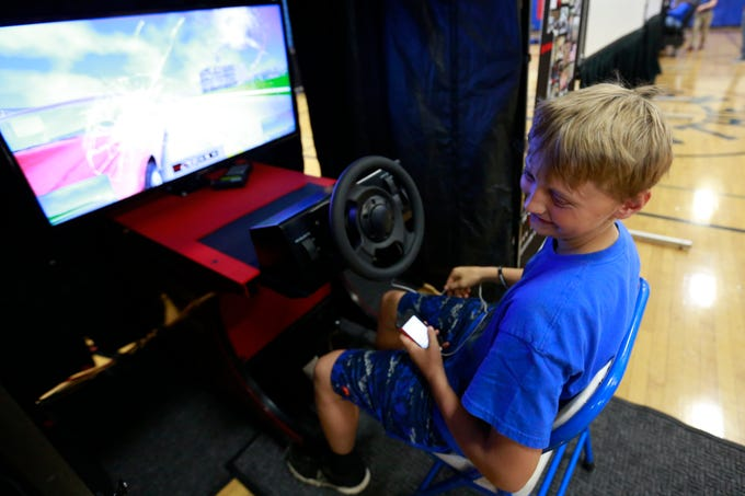 Student Cody Murkowski, 14, reacts after he made a crash on his driving simulation during the Save A Life Tour Wednesday, Sept. 19, 2018, at Athens High School in Athens, Wis. The Save A Life Tour is a comprehensive high impact safe driving awareness program that informs, educates, and demonstrates the potentially deadly consequences resulting from poor choices and decisions made by the operator of a motor vehicle. T'xer Zhon Kha/USA TODAY NETWORK-Wisconsin