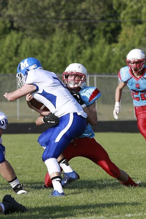 Newman's Gavin Wulf, right, tackles Chippewa Falls McDonell's Kendren Gullo during an 8-player football game earlier this season. The Cardinals will attempt to move to 6-0 with a homecoming matchup against Gibraltar on Saturday.
