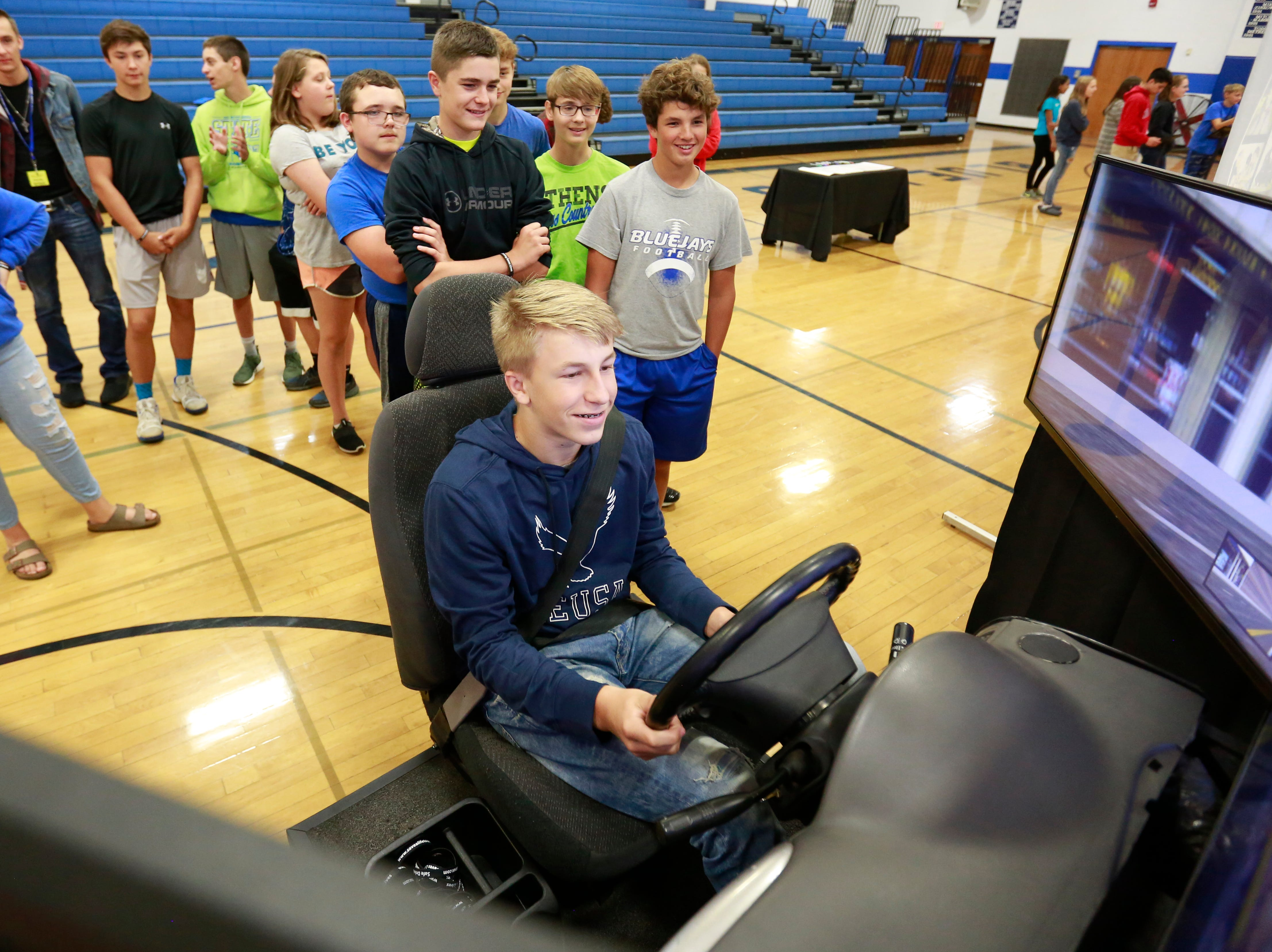 Cooper Diedrich, 15, drives a simulator while his classmates look on during the Save A Life Tour Wednesday, Sept. 19, 2018, at Athens High School in Athens, Wis. T'xer Zhon Kha/USA TODAY NETWORK-Wisconsin