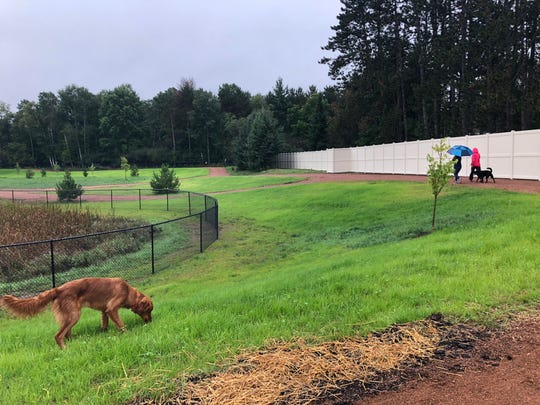 Dog owners and their pups enjoy Sandy's Bark Park in Rib Mountain on Sept. 20, 2018.