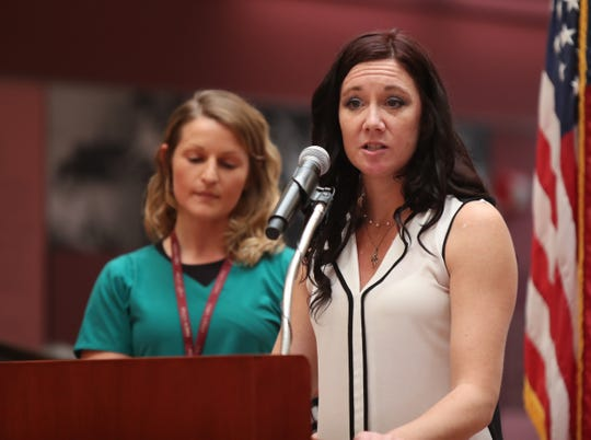 Jacquelyn Ryan, 34, front, from Pearl River offers remarks after receiving the Continuing Care Cup from Doctor of Physical Therapy, Francesca DeSimone during the 2018 Helen Hayes Hospital Honors Assembly at Helen Hayes Hospital in West Haverstraw on Thursday, September 20, 2018.