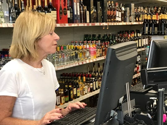 Linda Giacopelli, owner of the Hartsdale Wine Shop, four doors down from the proposed mega store, Total WIne & More.
