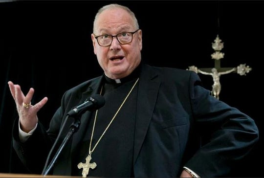 Cardinal Timothy Dolan addresses a news conference at the offices of the New York Archdiocese, in New York, Thursday, Sept. 20, 2018. The Roman Catholic Archdiocese of New York said  that it has hired former federal judge Barbara Jones to review its procedures and protocols for handling allegations of sexual abuse.