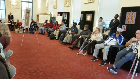Bus riders listen to testimony at a DART public hearing on Tuesday at the downtown Wilmington library.