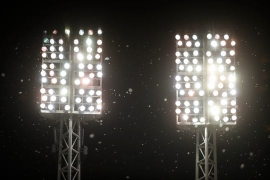In this June 27, 2017 file photo, mayflies swarm around the bright lights of a ballpark during a baseball game in Cincinnati. Experts say light pollution is a big problem for some species of insects. Certain bugs are attracted to brightness, where they become easy prey and expend energy they should be using to get food, said University of Delaware entomologist Doug Tallamy.