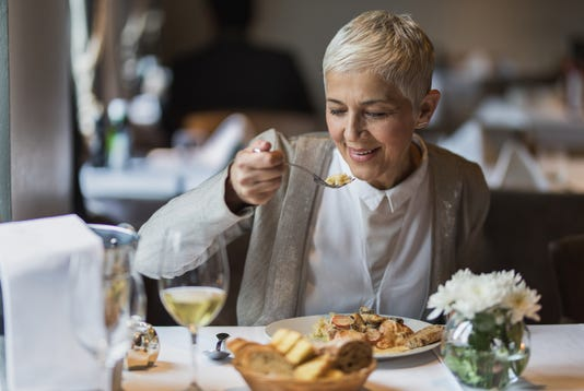 Happy Senior Woman Enjoying In Her Lunch In A Restaurant