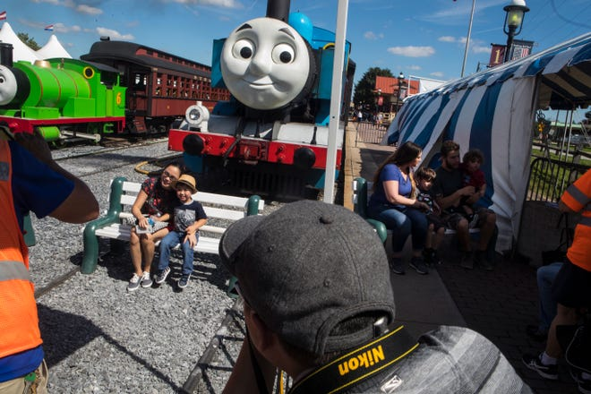 Families have their photo made with Thomas the Tank Engine and Percy at the Day Out With Thomas event at the Strasburg Rail Road Sunday, Sept. 16, 2018.