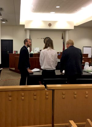 Kody Lott (center) talks with his defense team during the punishment phase of his murder trial Thursday morning in a Fort Worth courtroom.