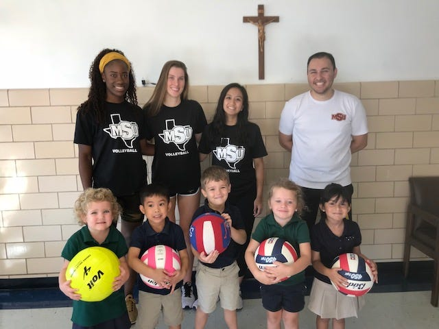 Some MSU volleyball players recently came to Notre Dame Elementary to teach beginning volleyball skills.  From the left: Raven Presley, Sarah Glawe, Samanda Manio and assistant coach Tim Alaniz; Notre Dame 3K and 4K students:  Ellie Kocher, Franco Baking, Alexander Gomez, Ellie Guidry and Valentina Juarez.