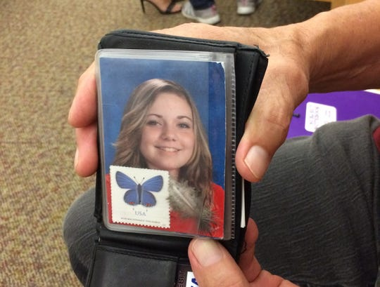 Don Landavazo, Lauren Landavazo's grandfather, carries her photo with keepsakes in his wallet.