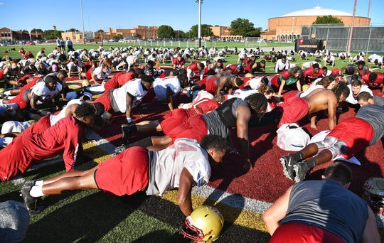 Midwestern State University football players and athletes of other sports gathered Wednesday after practice to honor teammate Robert Grays on the anniversary of his death one year ago from an injury during a game. Grays' jersey number was 24 and the team does 24 pushups after each practice.