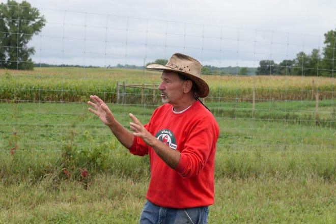 Greg Zwald of White Pine Berry Farm explains how the family runs its organic berry and vegetable farm as part of a recent St. Croix County Policymaker Farm Tour coordinated by the St. Croix County Farm Bureau. — at White Pine Berry Farm.