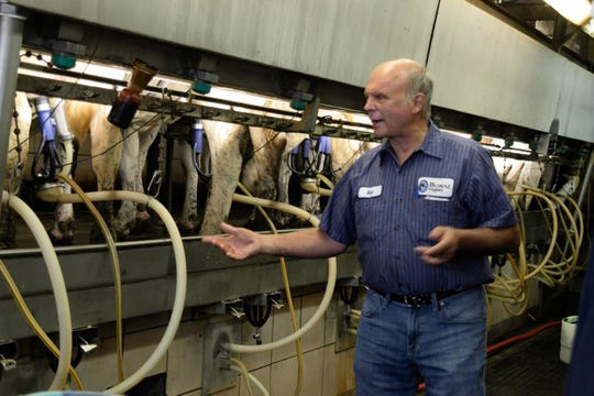 Bob Zwald talks about the milking herd at Bomaz Farms during a tour of elected officials and candidates at his family's dairy farm as part of a recent St. Croix County Policymaker Farm Tour coordinated by the St. Croix County Farm Bureau