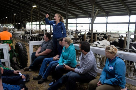 Annette Schalla of Bomaz Farms narrates during a wagon ride through the dairy's freestall barn.