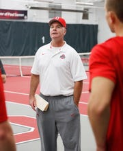 Ohio State tennis coach Ty Tucker talks to visitors to the university's tennis center.