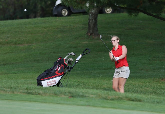 Sheridan's Liberty Justice hits onto the green during the MVL girls golf tournament at EagleSticks on Thursday.