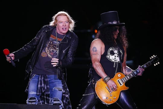 Guns N' Roses singer Axl Rose, left, and guitarist Slash perform in Chile last year.